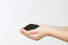Почва удерживания руки Стоковые Фото