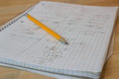 Почерк тетради математики грязный с желтым карандашем Стоковая Фотография