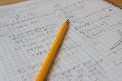 Почерк тетради математики открытый грязный с карандашем Стоковые Фото