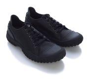 почерните ботинки Стоковые Фото