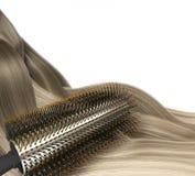 Почистьте волосы щеткой Стоковые Изображения RF