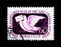 Почтовый голубь и глобусы, международное serie недели сочинительства письма, около 1957 Стоковые Изображения