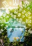 Почтовый ящик с значками письма на накаляя зеленой предпосылке Стоковые Изображения