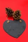 Пошлите любящее сообщение на черном сердце шифера Стоковые Фото