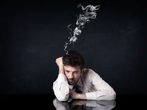 Подавленный бизнесмен с куря головой Стоковое фото RF