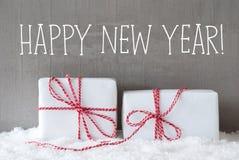 2 подарка с снегом, отправляют СМС счастливый Новый Год Стоковая Фотография