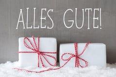 2 подарка с снегом, Alles Gute значат наилучшие пожелания Стоковое фото RF