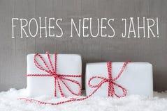 2 подарка с снегом, Frohes Neues значат счастливый Новый Год Стоковые Фотографии RF