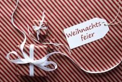 2 подарка с ярлыком, Weihnachtsfeier значат рождественскую вечеринку Стоковая Фотография RF