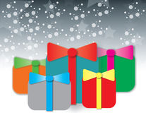 Подарки партии на серой предпосылке Стоковые Изображения