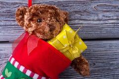 Подарки рождества в ботинке Стоковые Изображения