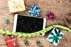 Подарки рождества на древесине Стоковые Фото