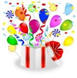 Подарок с яркими мраморами и леденцами на палочке воздуха Стоковые Фото