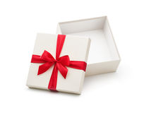 Подарочная коробка белизны открытая с красным смычком Стоковая Фотография RF