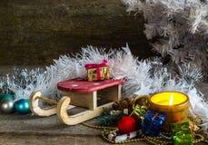 Подарочные коробки и сани рождества Стоковая Фотография