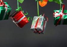 Подарочные коробки рождества на черной предпосылке Стоковые Изображения