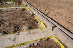 Подбетонки и фундамент нового дома для строительной конструкции Стоковые Фото