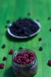 Поленики и ежевики ягод на деревянной предпосылке Стоковое Изображение