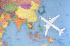 Полет к изображению Азии символическому перемещения плоской картой Стоковое Изображение RF