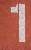 Поле и номер атлетики Стоковые Изображения RF