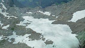 Поле снега в высоких горах Стоковое Изображение RF