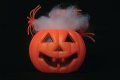 Поддельная тыква с spiderwebs Стоковая Фотография