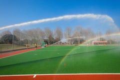 Поле Astro игры воды хоккея распыляя Стоковые Фото