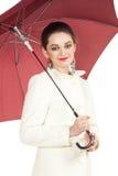 Под защитой зонтика Стоковые Изображения