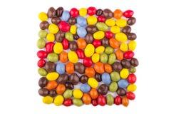 Полива покрашенная конфетой на белой предпосылке Стоковое Изображение RF