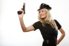 Полисмен женщина-полицейского с оружием Стоковая Фотография