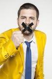 Политик загерметизировал его звонки рта для повстанчества стоковые изображения rf