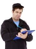 Полицейский пишет билет Стоковые Фотографии RF
