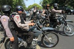 Полиция обеспечивает городок Стоковое Изображение RF