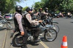 Полиция обеспечивает городок Стоковое Изображение