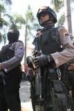 Полиция обеспечивает городок Стоковые Изображения