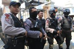 Полиция обеспечивает городок Стоковые Фотографии RF