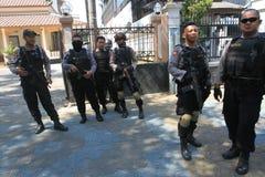 Полиция обеспечивает городок Стоковые Изображения RF