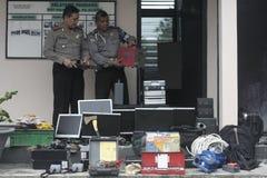 Полиция проводит сотни лишения права выкупа доказательства против результатов злодеяния Стоковые Изображения