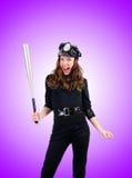Полиция с летучей мышью против градиента Стоковые Фото