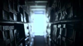 Полки документов, который хранят в архиве акции видеоматериалы