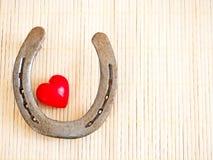 Подкова и сердце стоковое фото