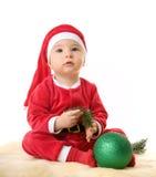 по мере того как мальчик claus одетьл маленький santa Стоковые Фото