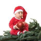 по мере того как мальчик claus одетьл маленький santa Стоковая Фотография