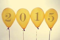 2015, по мере того как Новый Год, на золотых воздушных шарах, с влиянием фильтра Стоковая Фотография
