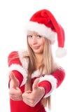 по мере того как одетьнная девушка ее большие пальцы руки santa вверх Стоковые Фотографии RF
