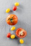 по мере того как предпосылка может обои используемые томатом Стоковое Изображение RF