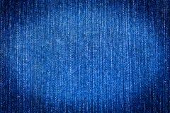 по мере того как текстура джинсыов предпосылки Стоковая Фотография RF