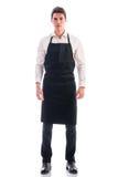 Полнометражная съемка молодой представлять шеф-повара или кельнера стоковые фотографии rf