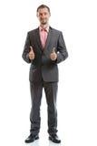 Полнометражный бизнесмен связи костюма Стоковые Фото