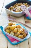 Зажаренные в духовке новые картошки Стоковые Фото